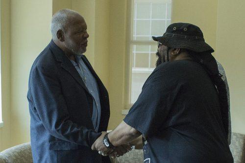 sir earl toon is shaking hands
